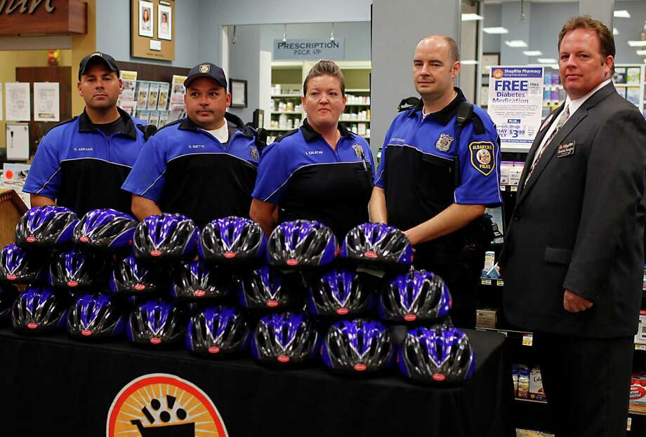 ShopRite Store Director Dominic Ausanio, right, stands with Albany police officers, from left, Nicholas Abrams, Dan Biette, Janet Zalatan and Matt Montesano at the Central Avenue ShopRite location for a media event Thursday July 26, 2012 in Albany, N.Y. ShopRite Supermarkets will donate 320 bicycle helmets in support of the Albany Police Department's Bicycle Rodeo taking place this Saturday, July 28th at Swinburne Park. (Dan Little/Special to the Times Union) Photo: Dan Little / Dan Little