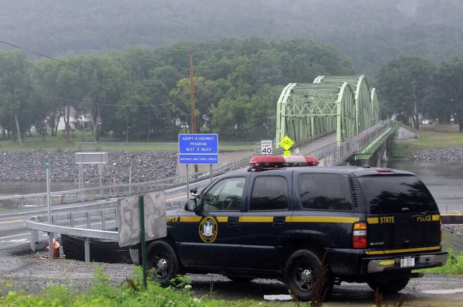 New York State Police search for an individual who fled a traffic stop near Routes 5 and 103 in Glenville NY Friday July 27, 2012. (Michael P. Farrell/Times Union) Photo: Michael P. Farrell