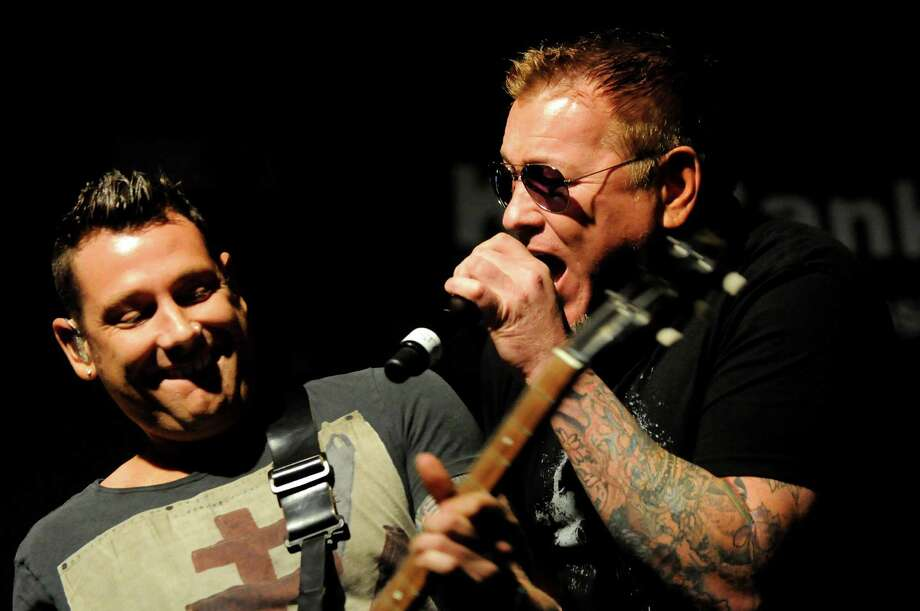 Lead singer Steve Harwell, right, performs with guitarist Mike Krompass and Smash Mouth at Alive at Five on Thursday, July 26, 2012, at Times Union Center in Albany, N.Y. (Cindy Schultz / Times Union) Photo: Cindy Schultz / 00018607A