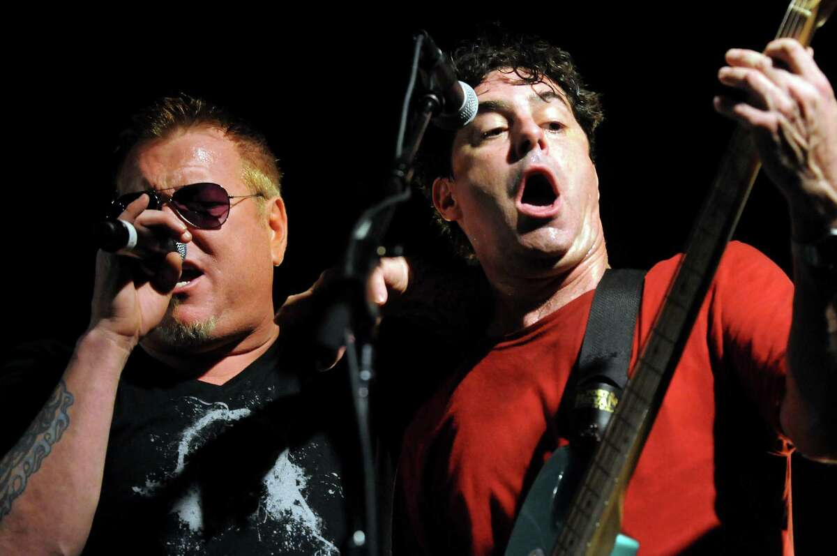 Lead singer Steve Harwell, left, performs with bassist Paul De Lisle and Smash Mouth at Alive at Five on Thursday, July 26, 2012, at Times Union Center in Albany, N.Y. (Cindy Schultz / Times Union)