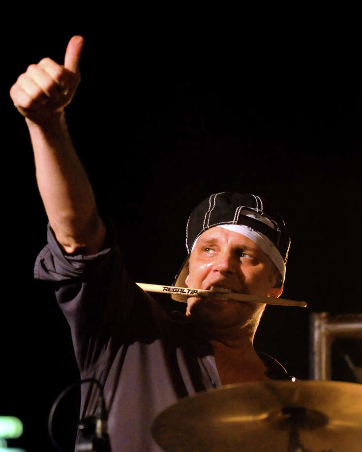 Drummer Randy Cooke salutes the crowd as he performs with Smash Mouth at Alive at Five on Thursday, July 26, 2012, at Times Union Center in Albany, N.Y. (Cindy Schultz / Times Union) Photo: Cindy Schultz / 00018607A
