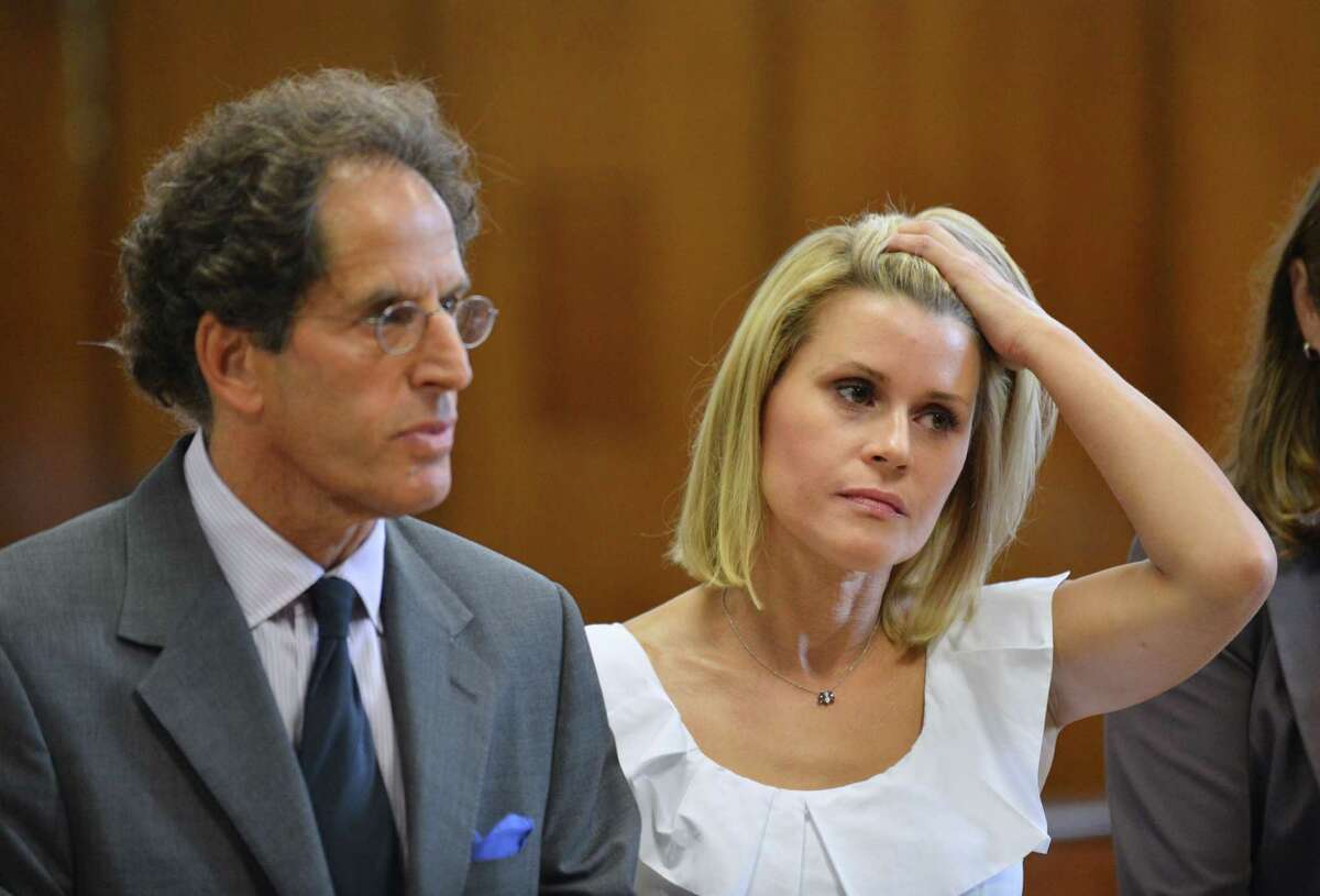 Canadian actress Genevieve Sabourin (R) with lawyer Maurice Sercarz (L) attend Manhattan Criminal Court in New York on July 26, 2012. The 40-year-old actress, who is accused of stalking actor Alec Baldwin, faces five charges including two counts of harassment in the second degree and stalking. AFP PHOTO/Stan HONDASTAN HONDA/AFP/GettyImages