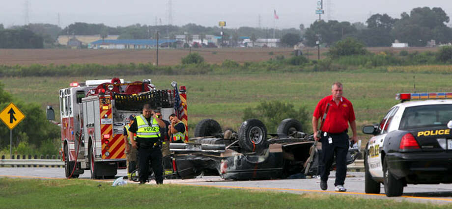 Police and firefighters work at the scene of a rollover accident on Loop 410 and Old Pearsall Road Friday morning July 27, 2012. The driver of the truck is in critical condition and the accident took place about 7:30 a.m. . Southbound lanes on Loop 410 in the area were closed so that investigators could continue probing the scene.