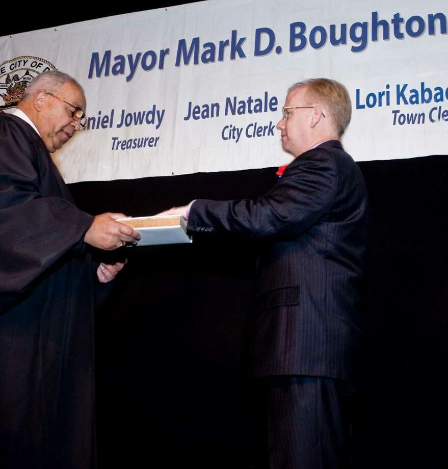 Judge Thomas West administers the Oath Of Office to Mayor Boughton during the swearing-in ceremony at the Palace theater. Monday, Nov. 30, 2009 Photo: Scott Mullin / The News-Times