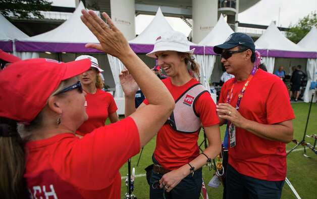 USA's Jennifer Nichols, center, gets a high five from team leader Cindy Bevilacqua after the women's archery ranking round at the 2012 London Olympics on Friday, July 27, 2012. Photo: Smiley N. Pool, Houston Chronicle / © 2012  Houston Chronicle