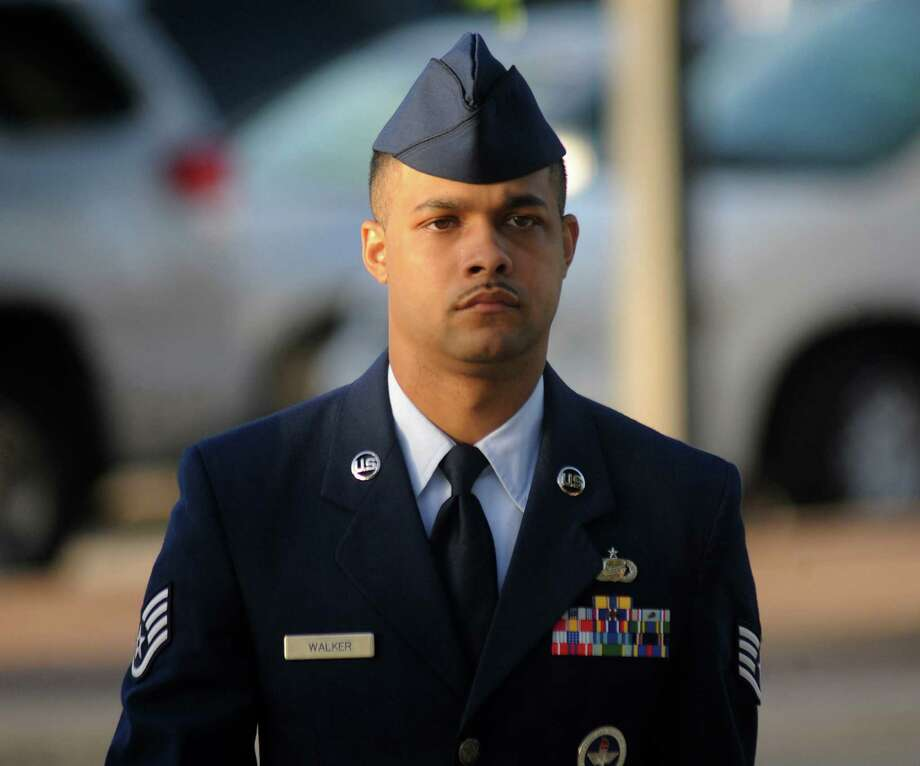 July 20, 2012:Air Force Staff Sgt. Luis Walker arrives for the fourth day of his trial at Lackland Air Force Base in San Antonio. Walker was accused of sexually assaulting 10 basic trainees, with charges ranging from rape and aggravated sexual assault to obstructing justice and violating rules of professional conduct. Read more: Staff Sgt. Walker found guilty on all charges of sexual misconduct Photo: Billy Calzada, Associated Press / San Antonio Express-News
