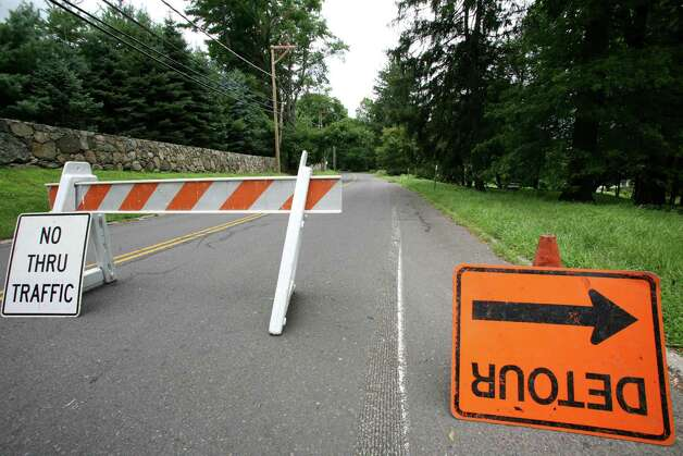 North Street remained closed Friday, July 27, 2012, after a tree fell on power lines during Thursday night's storm. Photo: David Ames / Greenwich Time