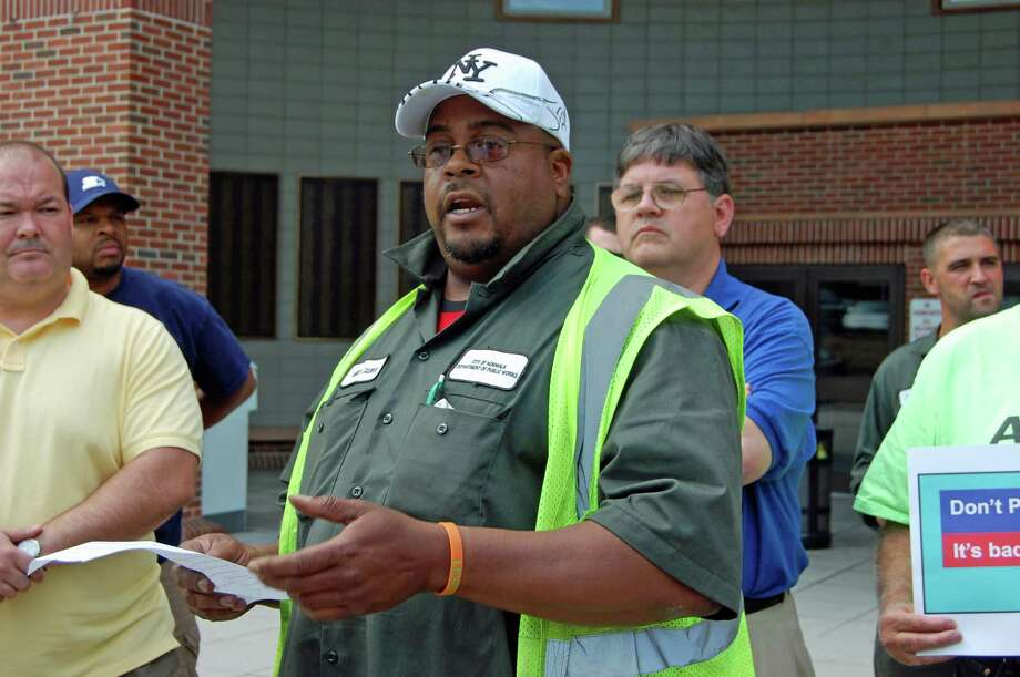 AFSCME Local 2405 president Milton Giddiens talks about why he opposes Norwalk's continued efforts to privatize trash collection at a press conference held outside City Hall June 19, the day contractors' bids were due for consideration. Photo: Nicole Rivard