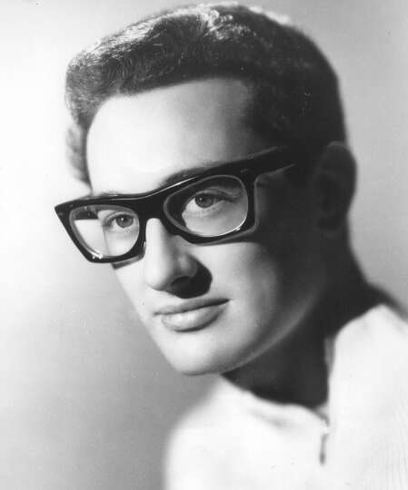 This 1959 file photo shows rock and roll singer, songwriter and guitarist, Buddy Holly at an unknown