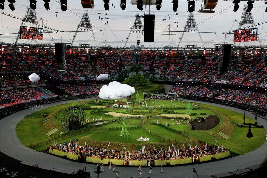 Floating clouds are escorted through the stadium prior to the Opening Ceremony of the London 2012 Olympic Games at the Olympic Stadium on July 27, 2012 in London, England. Photo: Quinn Rooney, Getty Images / 2012 Getty Images
