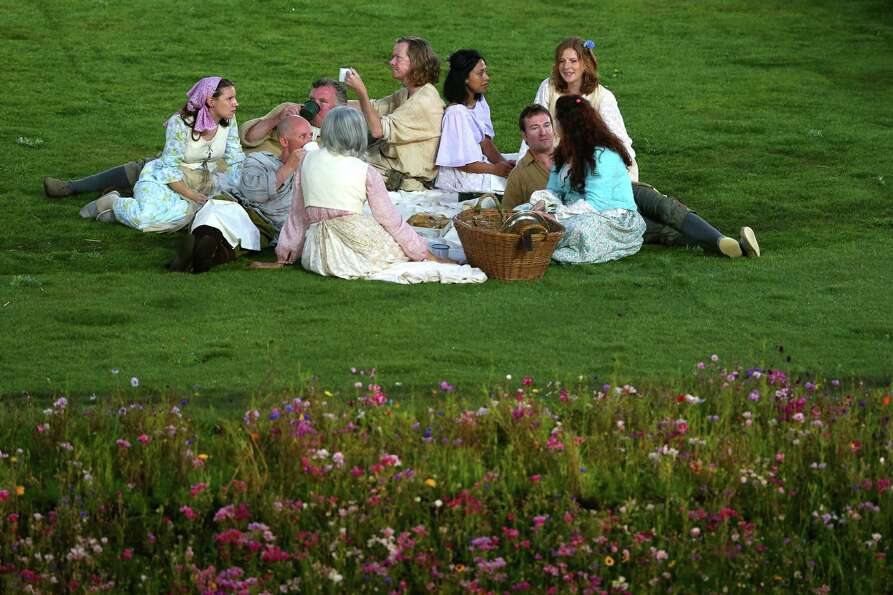 Performers stage a picnic during the preshow prior to the Opening Ceremony of the London 2012 Olympi