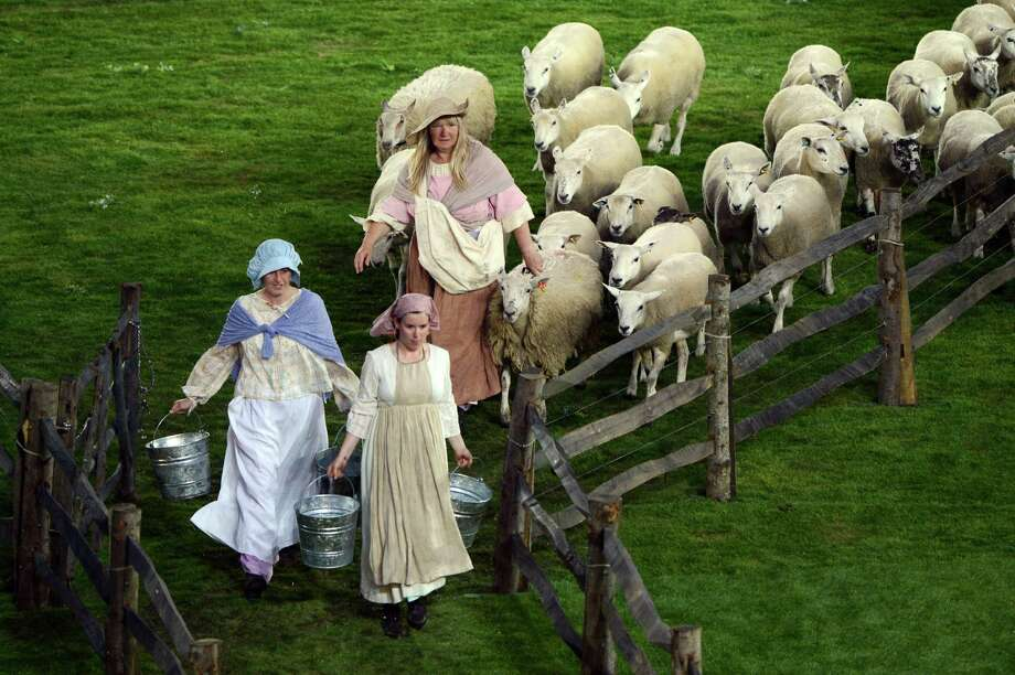 LONDON, ENGLAND - JULY 27:  A Shepherdess tends her flock during the Opening Ceremony of the London 2012 Olympic Games at the Olympic Stadium on July 27, 2012 in London, England. Photo: Getty Images