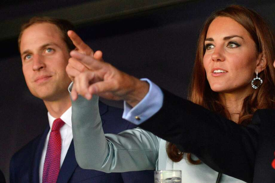 Prince William, Duke of Cambridge (left) and Catherine, Duchess of Cambridge attend the Opening Ceremony of the London 2012 Olympic Games at the Olympic Stadium on July 27, 2012 in London, England. Photo: Getty Images