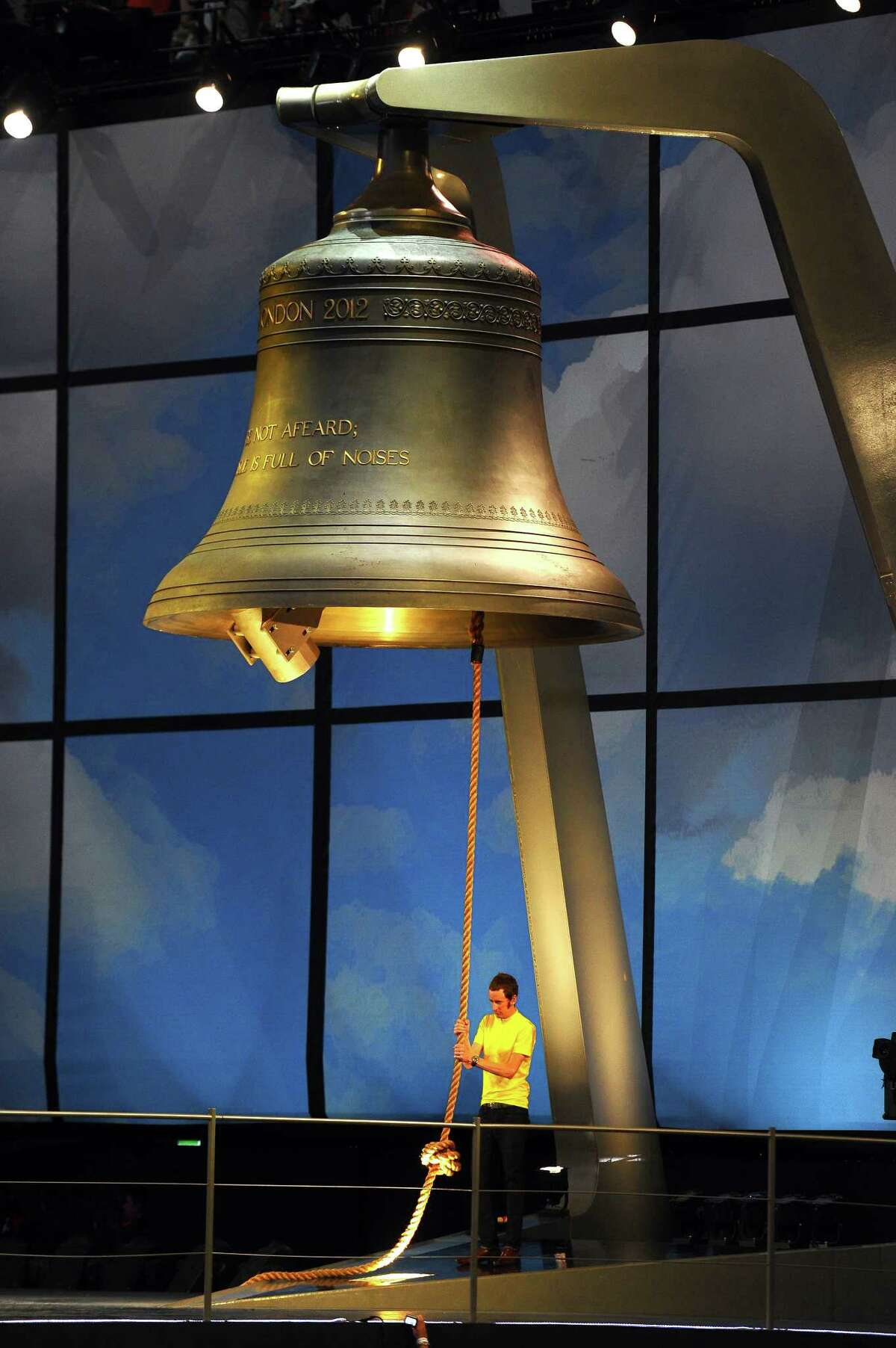 Bradley Wiggins the first British winner of the Tour De France cycle race rings the largest harmonically tuned bell in the world to signal the start of the Opening Ceremony of the London 2012 Olympic Games at the Olympic Stadium on July 27, 2012 in London, England.
