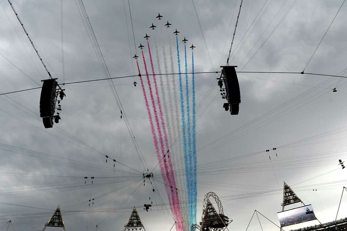The Red Arrows, the Royal Air Force aerobatic team fly over the stadium during the Opening Ceremony of the London 2012 Olympic Games at the Olympic Stadium on July 27, 2012 in London, England.