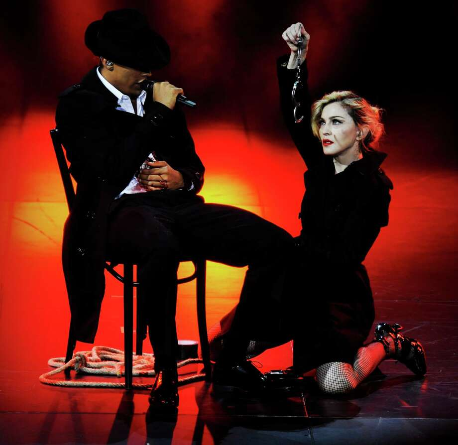 In this photo provided by Guy Oseary, Madonna performs on stage during her MDNA concert at Olympia Hall in Paris on Thursday, July 26, 2012. (AP Photo/Guy Oseary) Photo: Guy Oseary