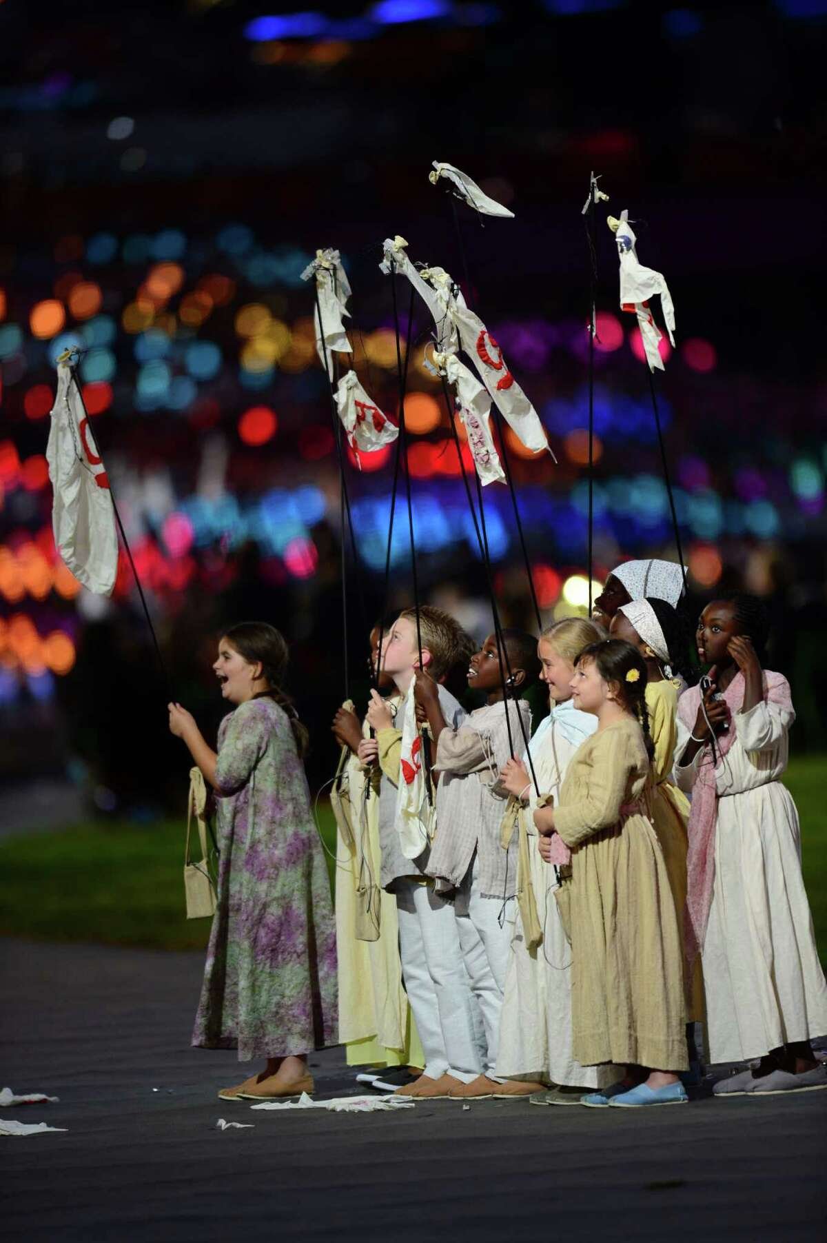 Children perform during the opening ceremony of the London 2012 Olympic Games on July 27, 2012 at the Olympic stadium in London.
