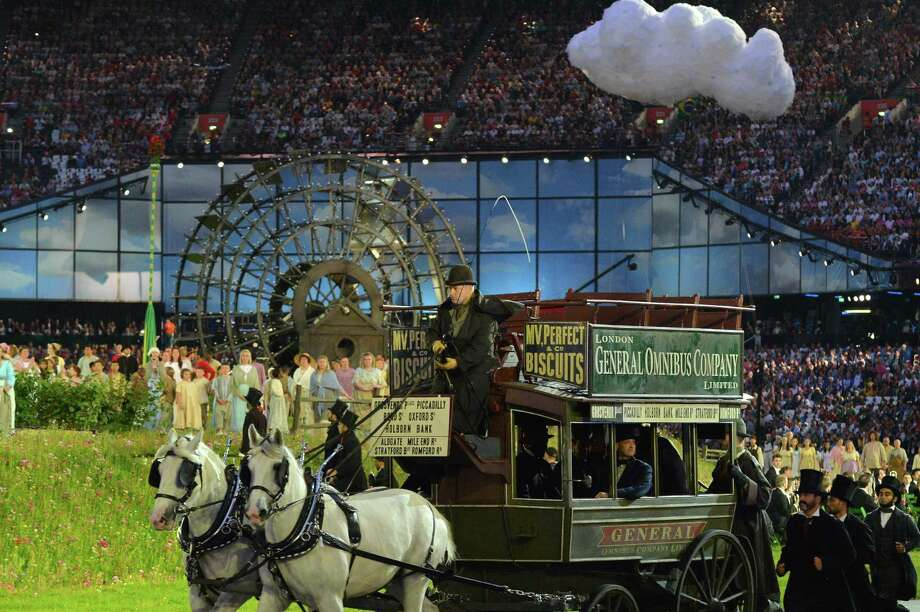 Artists arrive on a horse and carriage during the opening ceremony of the London 2012 Olympic Games on July 27, 2012 at the Olympic Stadium in London.  Photo: JEWEL SAMAD, AFP/Getty Images / 2012 AFP