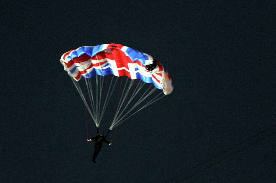 A performer in the role of Daniel Craig as James Bond parachutes out of a helicopter with a Union Jack parachute during the Opening Ceremony of the London 2012 Olympic Games at the Olympic Stadium on July 27, 2012 in London, England. Photo: Getty Images
