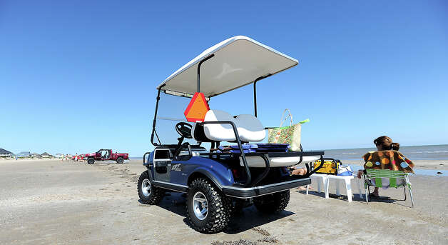 The signage on the back of the golf cart shown here lets drivers of other vehicles know this is a slow moving vehicle. Photo taken Saturday,  April 21, 2012. Tammy McKinley/The Enterprise Photo: TAMMY MCKINLEY