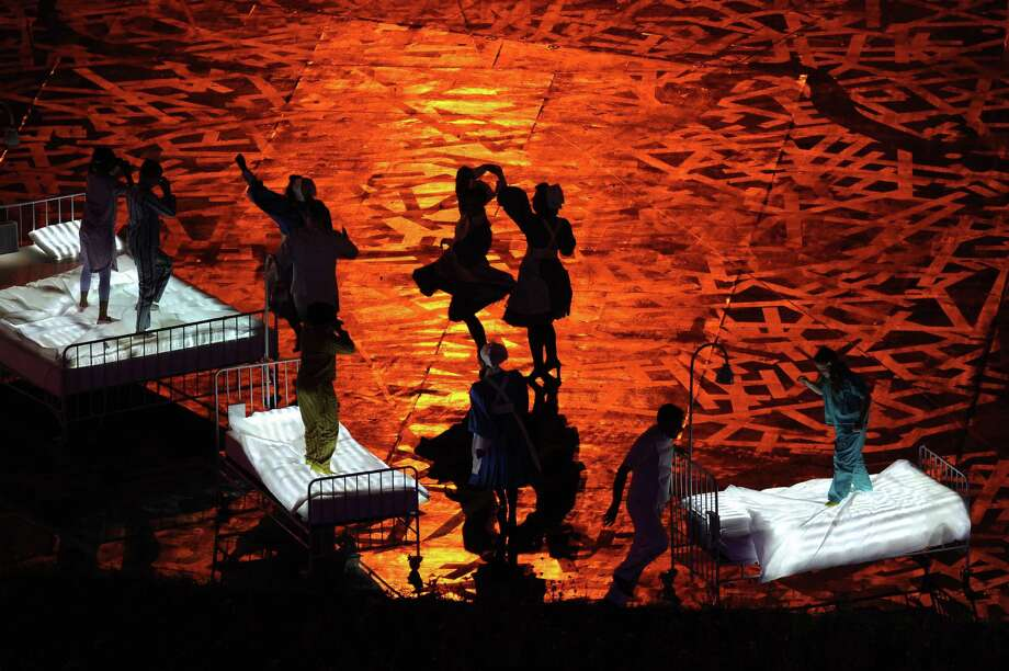 Performers dance during the Opening Ceremony of the London 2012 Olympic Games at the Olympic Stadium on July 27, 2012 in London, England. Photo: Getty Images