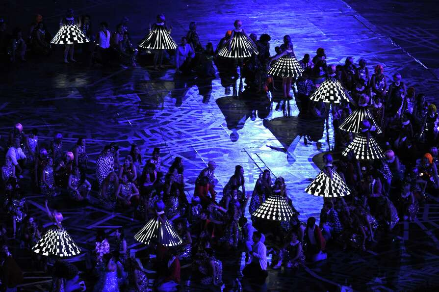 Performers dance during the Opening Ceremony of the London 2012 Olympic Games at the Olympic Stadium
