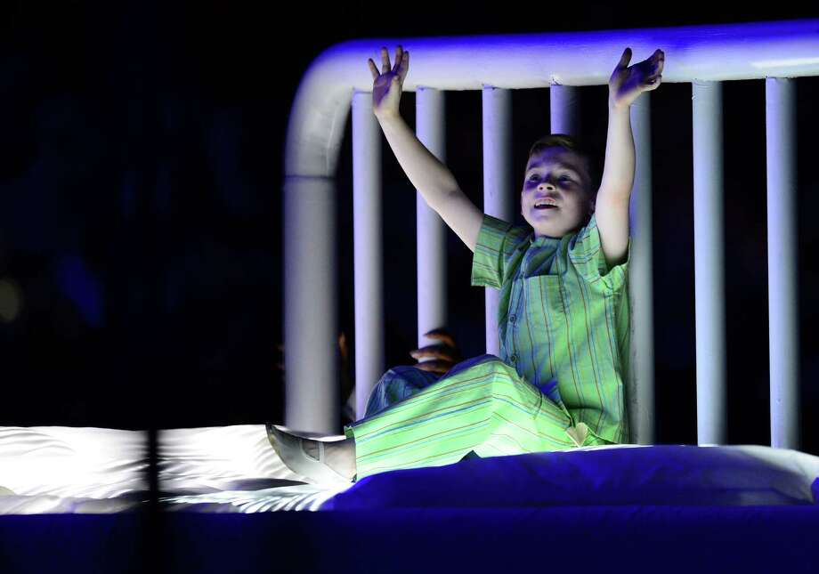 A child jumps on a hospital bed during the Great Ormond Street Hospital scene in the opening ceremony of the London 2012 Olympic Games at the Olympic Stadium in London on July 27, 2012.  Photo: OLIVIER MORIN, AFP/Getty Images / 2012 AFP