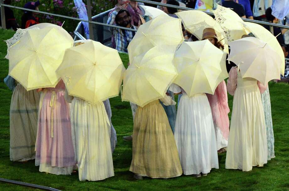 Actors perform in the British meadow scene during the opening ceremony of the London 2012 Olympic Games on July 27, 2012 at the Olympic stadium in London. Photo: EMMANUEL DUNAND, AFP/Getty Images / 2012 AFP