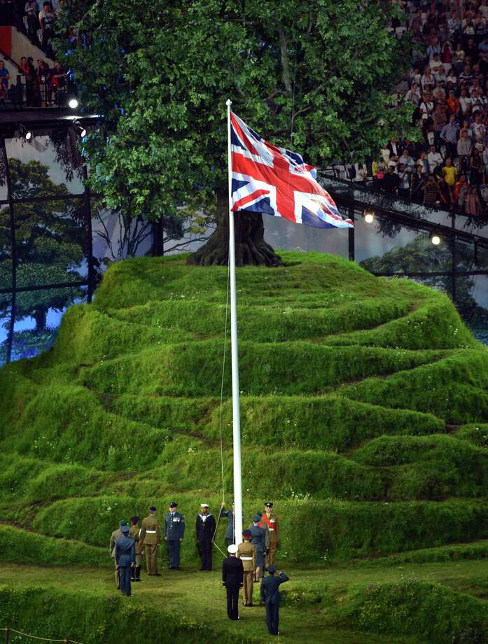 The Union Jack is hoisted during the opening ceremony of the London 2012 Olympic Games at the Olympic Stadium in London on July 27, 2012. Photo: SAEED KHAN, AFP/Getty Images / 2012 AFP