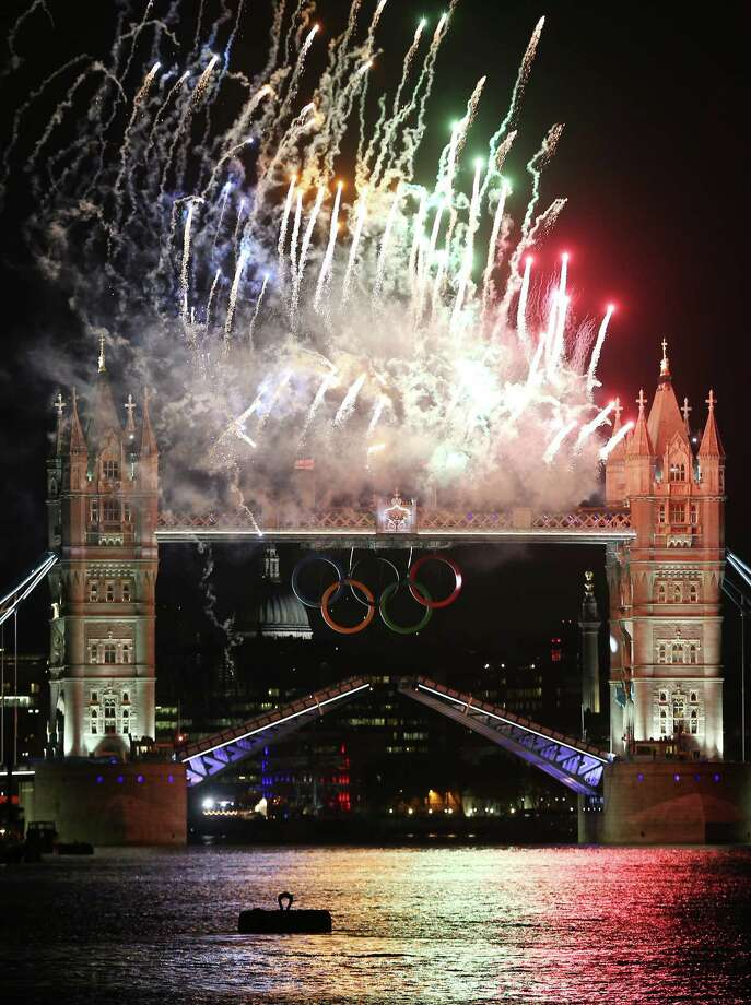 Fireworks light up Tower Bridge as the London 2012 Olympics opening ceremony takes place on July 27, 2012 in London, England. Athletes, heads of state and dignitaries from around the world have gathered in the Olympic Stadium for the opening ceremony of the 30th Olympiad. London plays host to the 2012 Olympic Games which will see 26 sports contested by 10,500 athletes over 17 days of competition. Photo: Getty Images