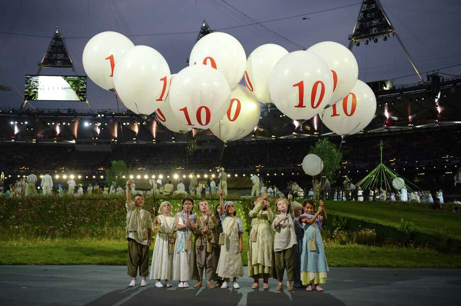Children perform during the British meadow scene of the opening ceremony of the London 2012 Olympic Games on July 27, 2012 at the Olympic stadium in London. Photo: LEON NEAL, AFP/Getty Images / 2012 AFP