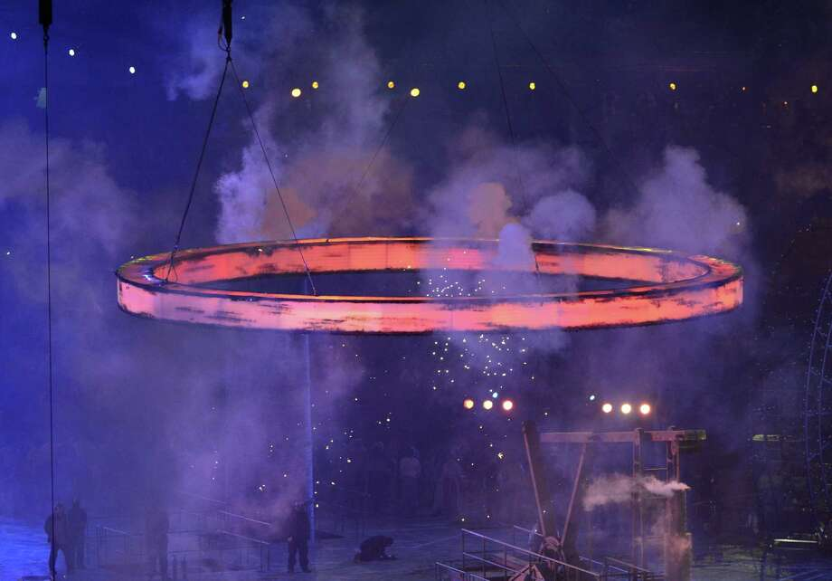 """A freshly """"forged"""" Olympic Ring flies during The Age of Industry scene in  the opening ceremony of the London 2012 Olympic Games on July 27, 2012 at the Olympic stadium in London. Photo: EMMANUEL DUNAND, AFP/Getty Images / 2012 AFP"""