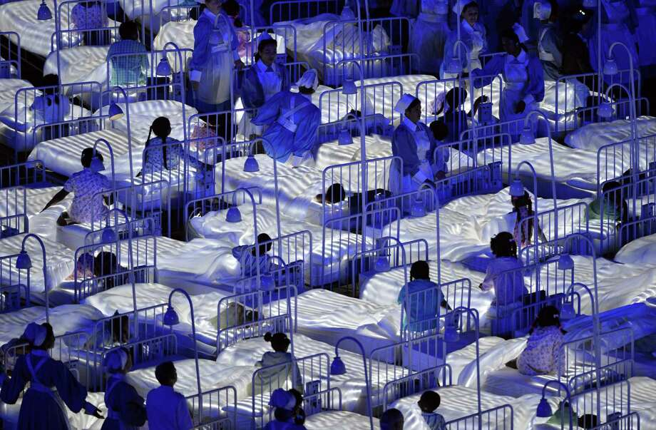Actors perform during the opening ceremony of the London 2012 Olympic Games at the Olympic Stadium in London on July 27, 2012.  Photo: SAEED KHAN, AFP/Getty Images / 2012 AFP