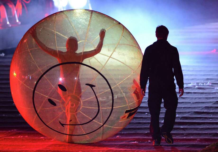 A performer in an orb takes part in the opening ceremony of the London 2012 Olympic Games at the Olympic Stadium in London on July 27, 2012. Photo: CHRISTOPHE SIMON, AFP/Getty Images / 2012 AFP