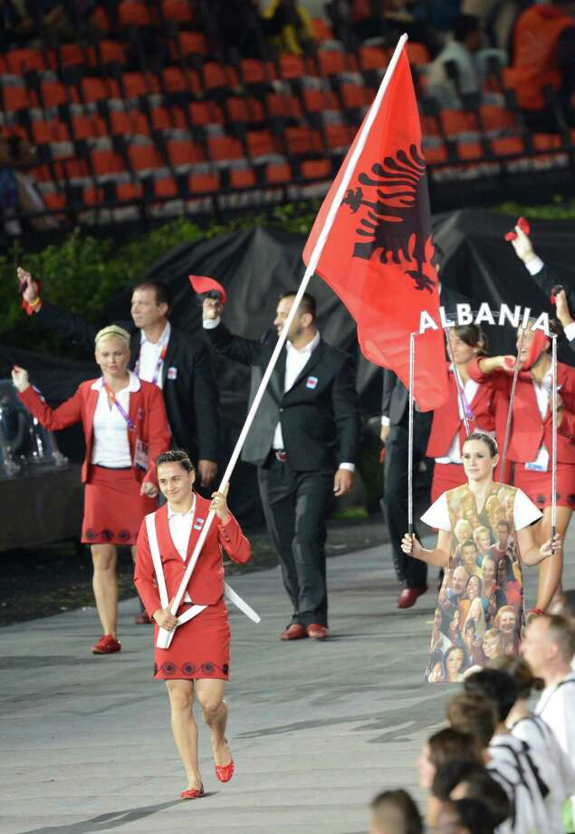 Albania's flagbearer Romela Begaj  leads her delegation during the opening ceremony of the London 2012 Olympic Games in the Olympic Stadium in London on July 27, 2012.  AFP PHOTO / CHRISTOPHE SIMON        (Photo credit should read CHRISTOPHE SIMON/AFP/GettyImages) Photo: CHRISTOPHE SIMON, AFP/Getty Images / 2012 AFP