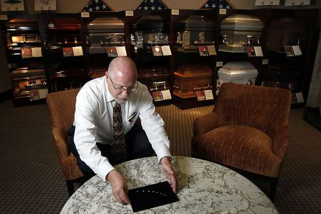 Funeral director Don van Straaten (cq) shows diamonds made from cremated remains at Alta Mesa Funeral Home in Palo Alto, Calif., Thursday, July 26, 2012.  A company, LifeGem, takes the carbon from cremated remains and grows a diamond crystal with it. Photo: Sarah Rice, Special To The Chronicle