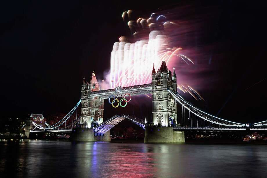 Fireworks explode from Tower Bridge during the opening ceremony of the London 2012 Olympic Games. Photo: Streeter Lecka / 2012 Getty Images
