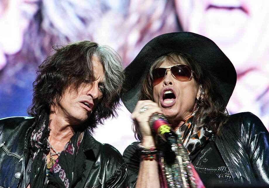 A handout picture released by Flash Entertainment shows US rock band Aerosmith's frontman Steven Tyler (R) and guitarist Joe Perry performing at the end of the Abu Dhabi Grand Prix in the Gulf emirate late on November 1, 2009. AFP PHOTO/HO == RESTRICTED TO EDITORIAL USE == (Photo credit should read -/AFP/Getty Images) Photo: - / FLASH ENTERTAINMENT