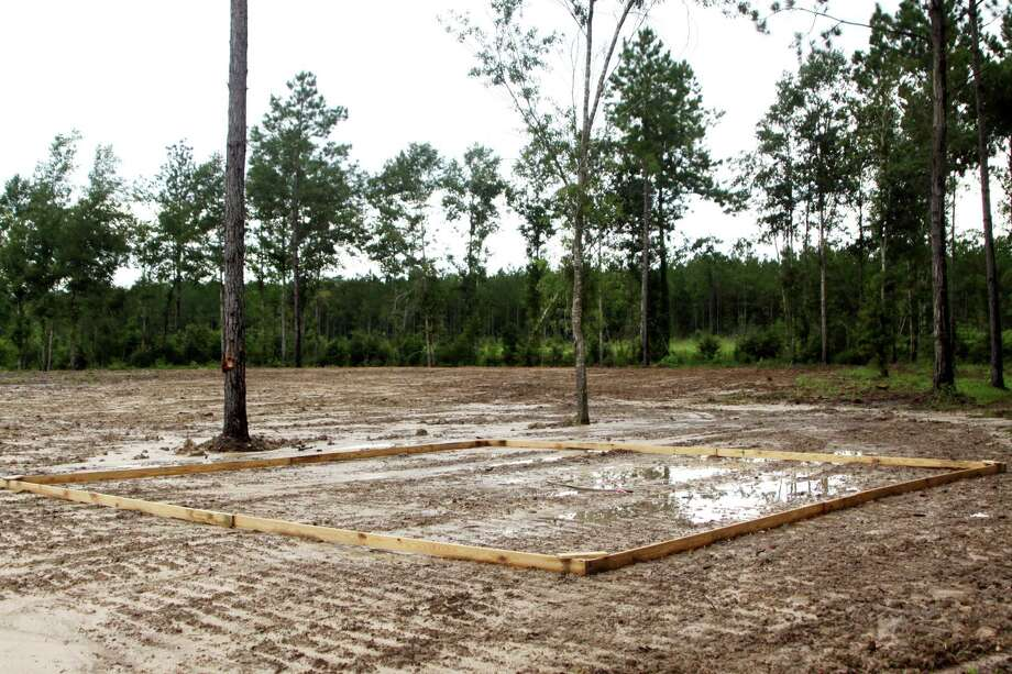 A wood form outlines the area where a 24X24 foot pavilion will be constructed at Lumberton City Park on FM 421. The dirt area in the background is where playground areas will be installed. The project is anticipated to be completed in fall, 2012. Photo: David Lisenby, HCN_Park