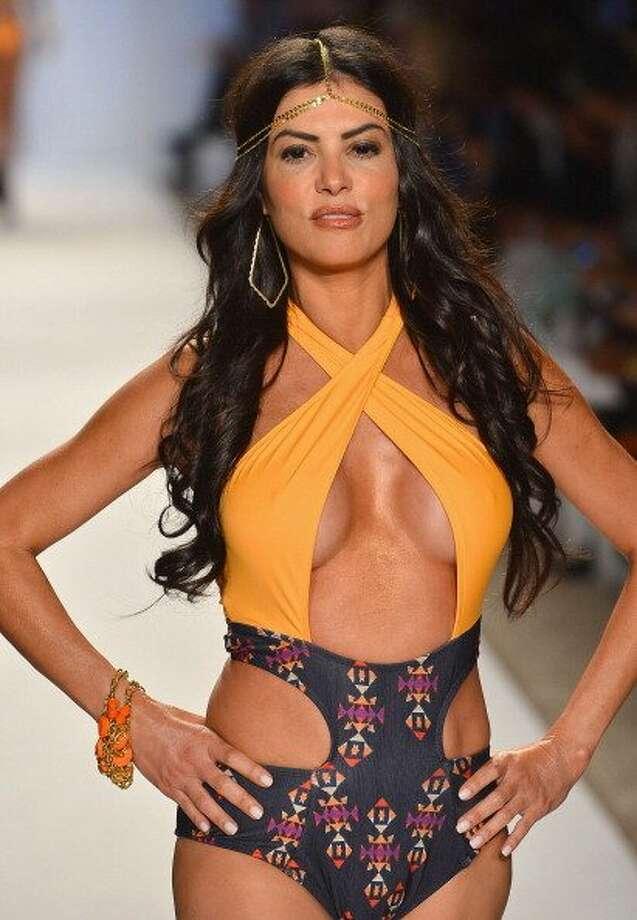 A model walks the runway at the Keva J show during Mercedes-Benz Fashion Week Swim 2013 in Miami Beach, Florida.   (Frazer Harrison / Getty Images )