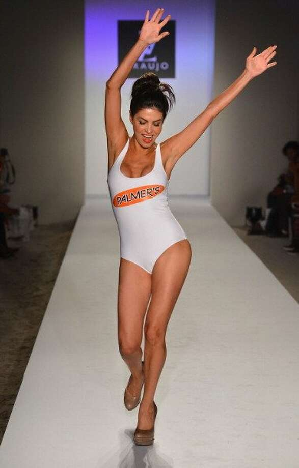 A model walks the runway at the A.Z Araujo show during Mercedes-Benz Fashion Week Swim 2013 in Miami Beach, Florida.   (Frazer Harrison / Getty Images)