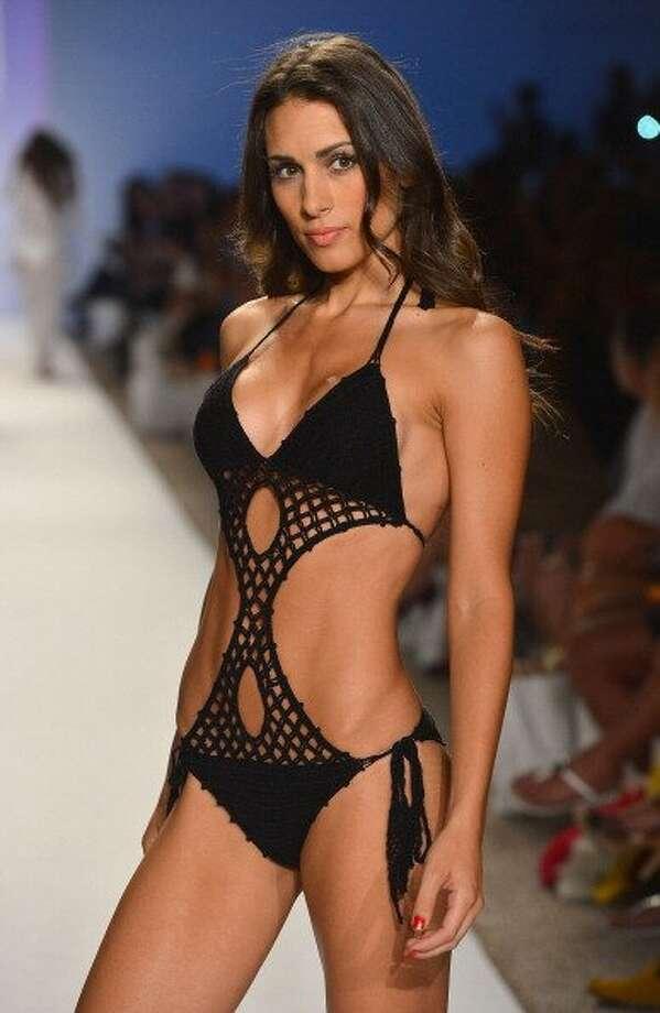 A model walks the runway at the Anna Kosturova show during Mercedes-Benz Fashion Week Swim 2013 in Miami Beach, Florida.   (Frazer Harrison / Getty Images )