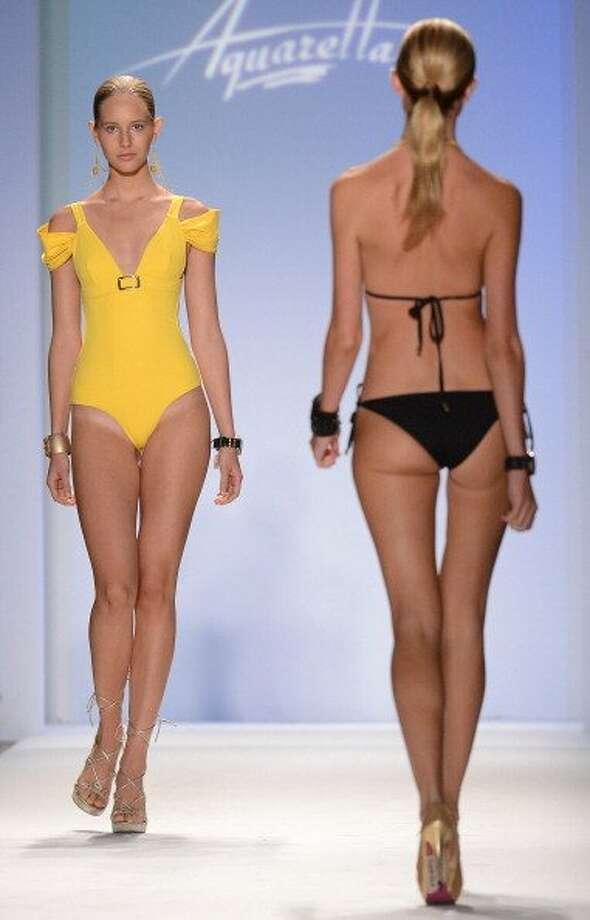 A model walks the runway at Aquarella Swimwear show during Mercedes-Benz Fashion Week Swim 2013 in Miami Beach, Florida.  (Joe Klamar / Getty Images)