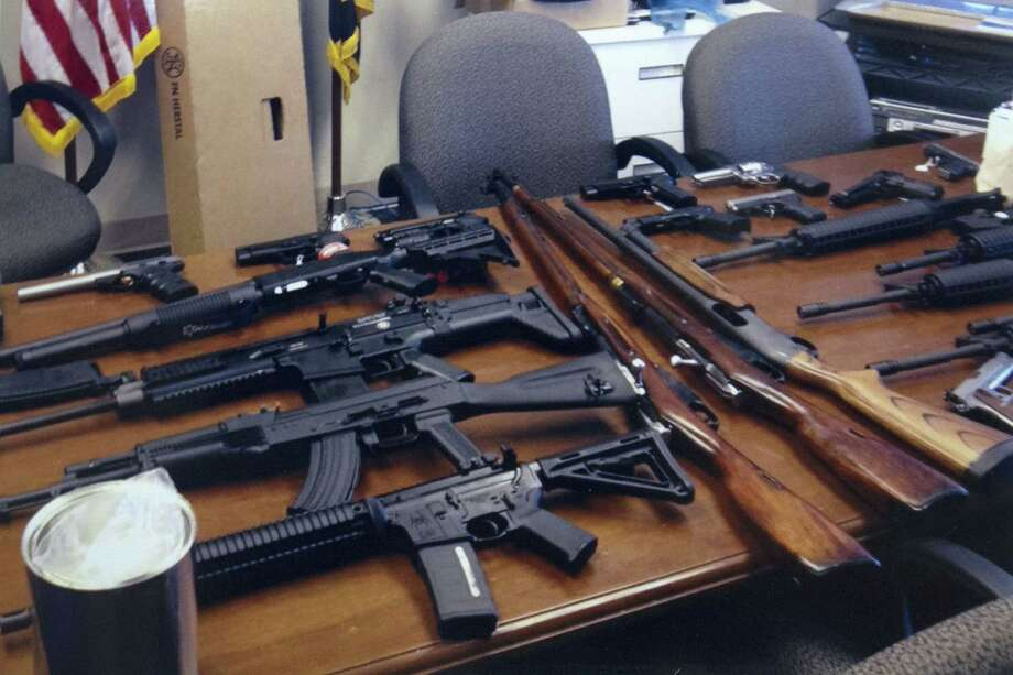 "This undated handout photo provided by the Prince George's, Md. County Police shows weapons found in the possession of a suspect who they say was plotting a shooting in his workplace. Police in Maryland say a man who called himself ""a joker"" and threatened to shoot up his workplace was in the process of being fired. Police say the 28-year-old man was taken into custody Friday morning. Investigators said he was wearing a T-shirt that said ""Guns don't kill people. I do."" He was taken into custody for an emergency mental health evaluation and charges are pending. Photo: AP"