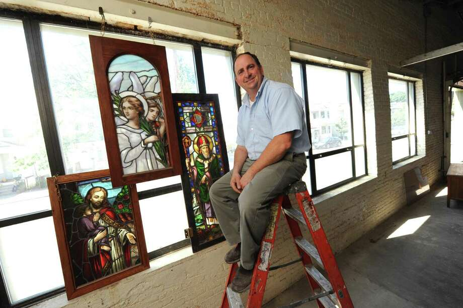 Stained glass artist Kevin Morgan owner of Chapman Stained Glass Studio in Albany NY Wednesday July 25, 2012. (Michael P. Farrell/Times Union) Photo: Michael P. Farrell