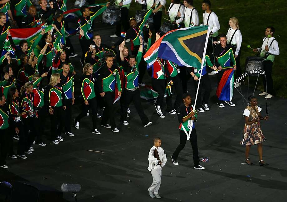 LONDON, ENGLAND - JULY 27: Caster Semenya of the South Africa Olympic athletics team carries her country's flag during the Opening Ceremony of the London 2012 Olympic Games at the Olympic Stadium on July 27, 2012 in London, England.  (Photo by Paul Gilham/Getty Images) Photo: Paul Gilham, Getty Images