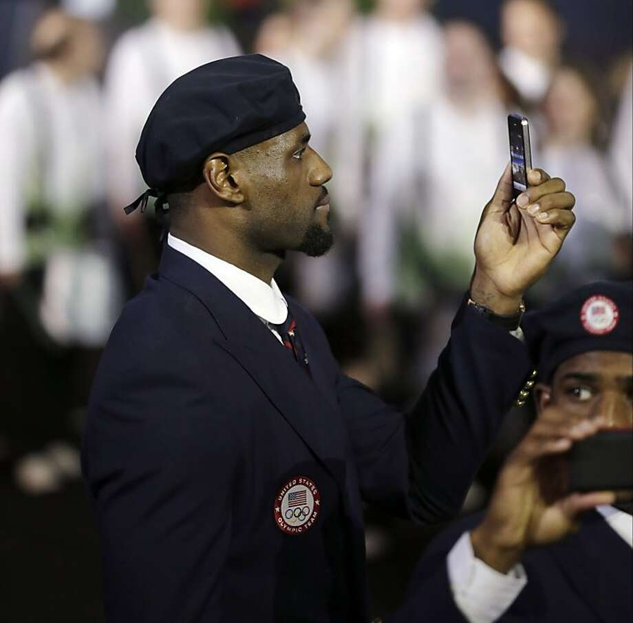 Professional basketball player LeBron James takes pictures with the United States' Olympic team during the Opening Ceremony at the 2012 Summer Olympics, Friday, July 27, 2012, in London. Photo: Matt Slocum, Associated Press