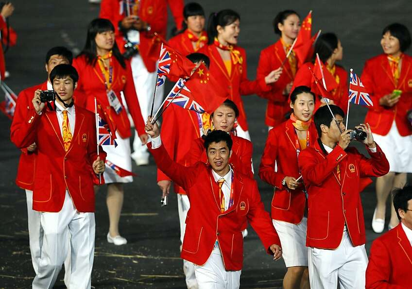 LONDON, ENGLAND - JULY 27:  Members of the China team wave Union Jacks as they parade into the stadi