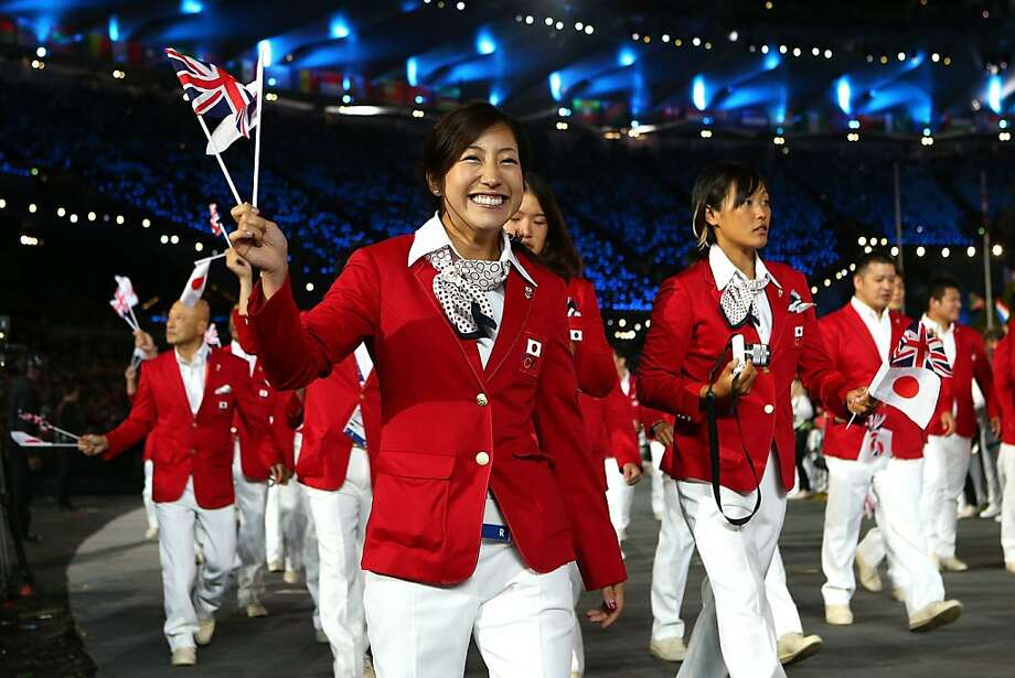 LONDON, ENGLAND - JULY 27:  Members of the Japanese Olympic team enter the stadium during the Opening Ceremony of the London 2012 Olympic Games at the Olympic Stadium on July 27, 2012 in London, England.  (Photo by Cameron Spencer/Getty Images) Photo: Cameron Spencer, Getty Images