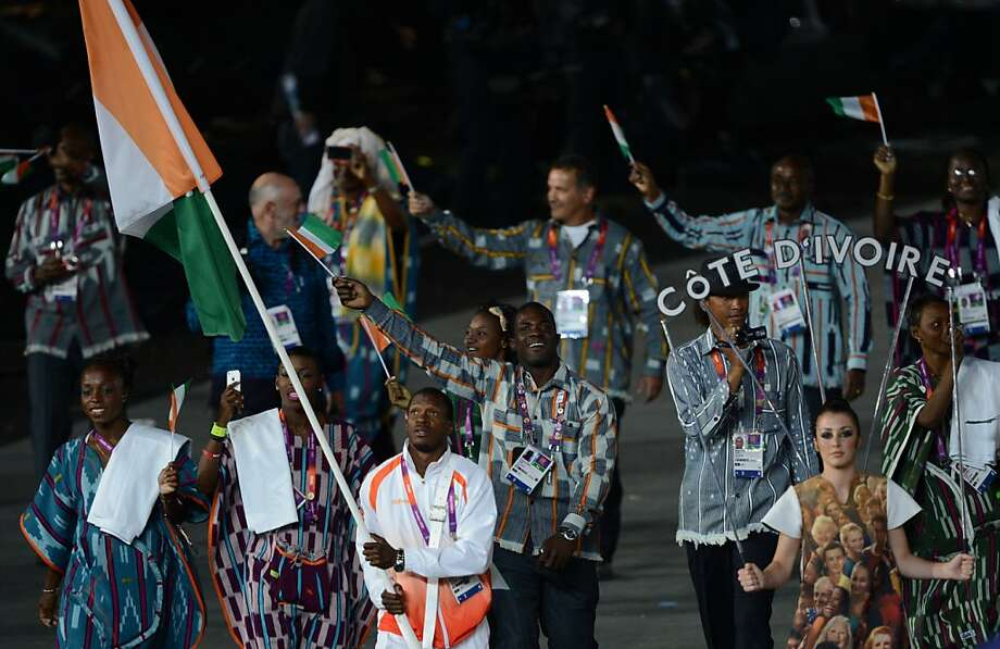 Ivory Coast's flagbearer Ben Youssef Meite leads his delegation parade in the opening ceremony of the London 2012 Olympic Games in the Olympic Stadium in London on July 27, 2012.  AFP PHOTO / CHRISTOPHE SIMONCHRISTOPHE SIMON/AFP/GettyImages Photo: Christophe Simon, AFP/Getty Images